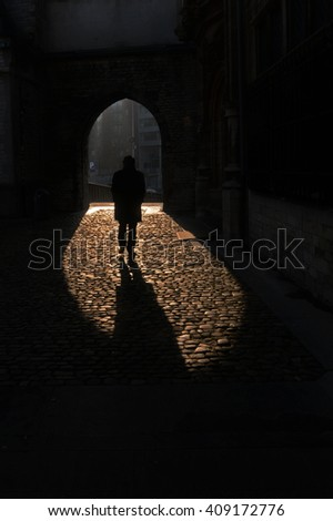 Man in shadows - stock photo