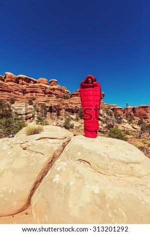 Man in sleeping bag - stock photo