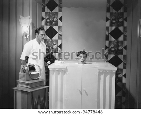 Man in steam bath with assistant and dictaphone - stock photo