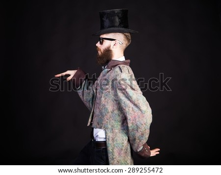 Man in strange outfit making a strange gesture. - stock photo