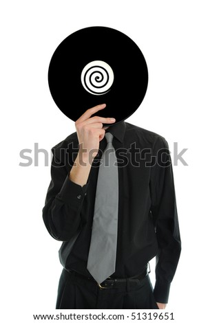 Man in suit and tie holds up a record LP to his head
