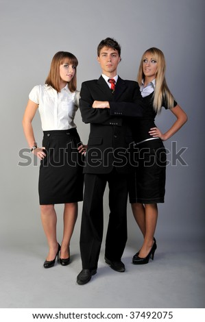 man in suit and two women