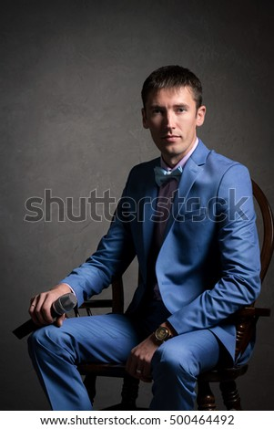 man in suit, business portrait, posing at Studio