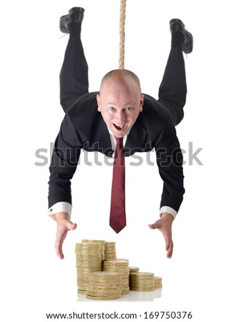 Man in suit dropping down to grab money isolated on a white background - stock photo