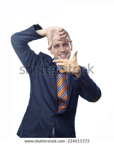 Man in suit framing her face with hands