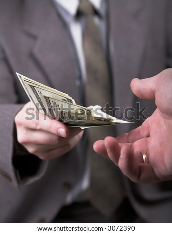 man in suit giving 1000 dollars another man - stock photo