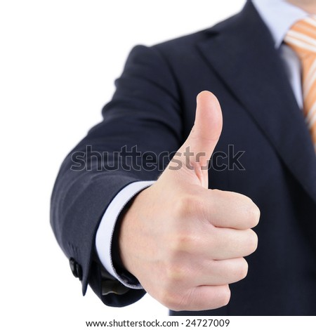 Man in suit is giving the thumb's up sign. - stock photo