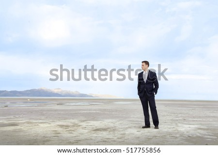 Man in suit looking out over the salt flats and great salt lake