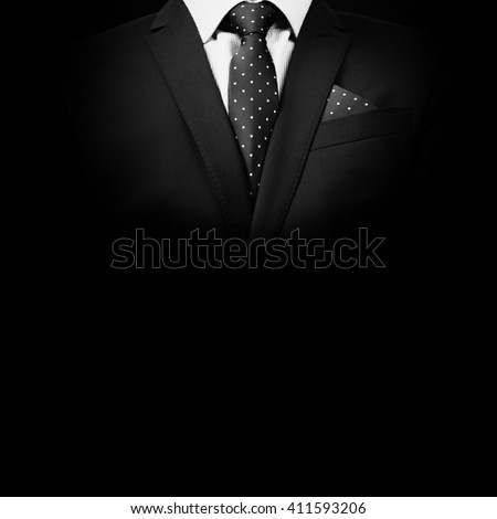 man in suit on a black background. studio shot - stock photo