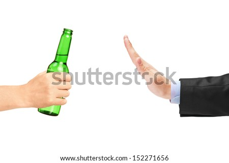 Man in suit refusing a bottle of beer isolated on white background - stock photo