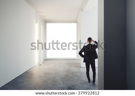 Man in suit walks on the exhibition hall and gallery