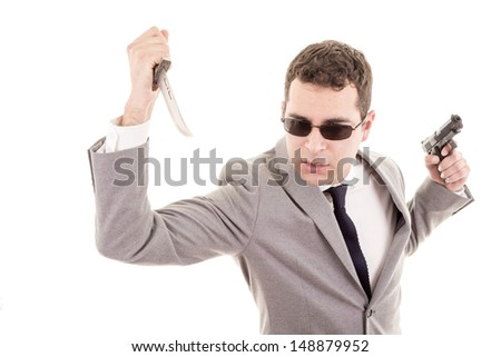 Man in suit with knive and gun - stock photo