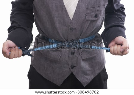 Man in suit with measuring tape on white background. - stock photo