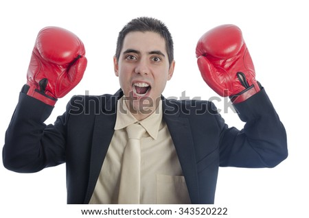 Man in suit with red boxing gloves with his arms up shouting over white background. - stock photo