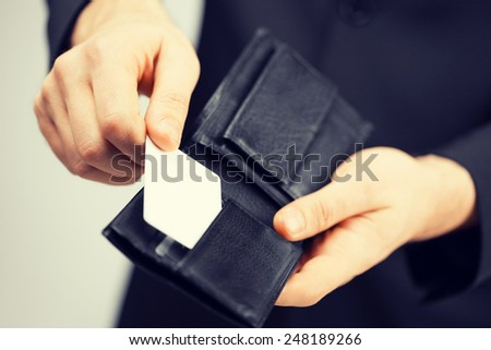 man in suit with wallet and credit card. - stock photo