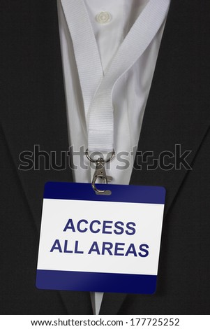 man in suite wearing an Access all Areas pass arround his neck - stock photo