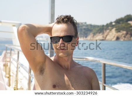man in sunglasses on a boat in the sun