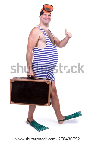 Man in swim dress walking with suitcase - stock photo