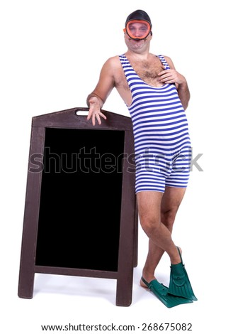 Man in swimsuit standing beside menu - stock photo