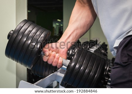 man in the gym doing exercises - stock photo