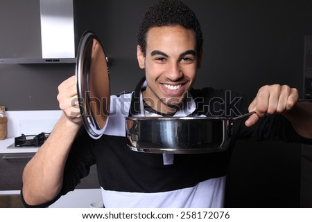 man in the kitchen - stock photo