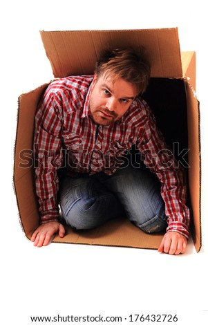 man in the paper box - stock photo