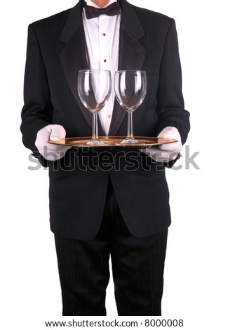 Man in Tuxedo and Formal Gloves Holding Tray and Wine Glasses isolated over white - stock photo