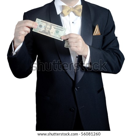 Man in tuxedo holding 20 dollar bill - stock photo