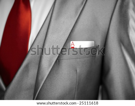 man in tuxedo jacket with an ace in his pocket - stock photo