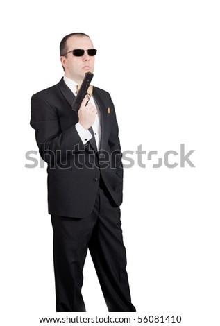 Man in tuxedo looking at his gun