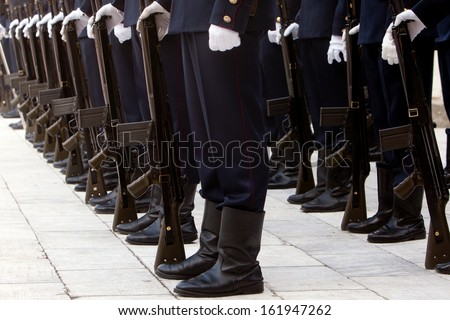 Man in uniform and rifles - stock photo