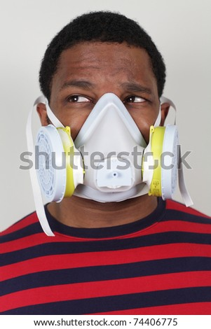 Man in Ventilation mask looking away - stock photo