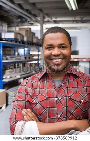 Man in warehouse - stock photo