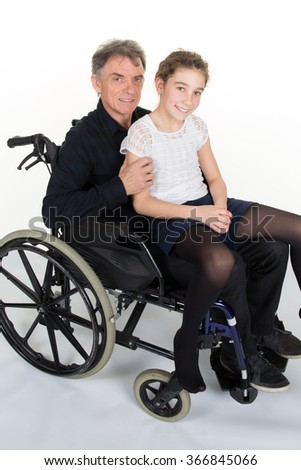 Man in wheelchair with his grand daughter isolated - stock photo