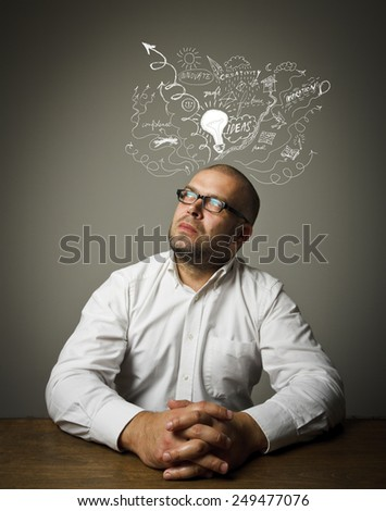 Man in white is full of ideas. Concept of ideas and fantasy. - stock photo