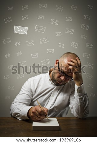Man in white is ready to write something. Letter concept. - stock photo
