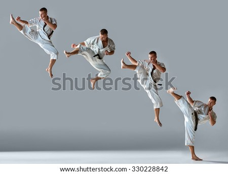 Man in white kimono and black belt training karate over gray background Collage - stock photo
