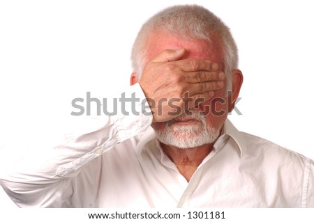 Man in white shirt covers eyes - stock photo