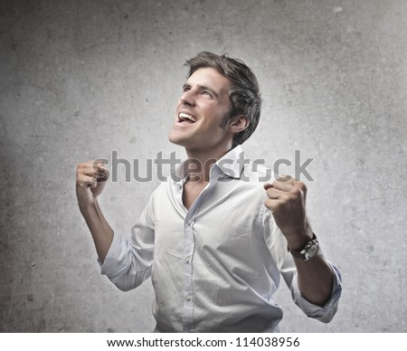 Man in white shirt exulting - stock photo