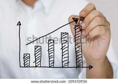 Man in white shirt sketching success graph - stock photo