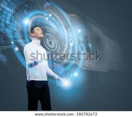 Man in white touching icon of media screen - stock photo