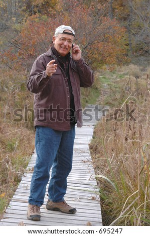 man in wilderness on cell phone 224