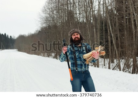 man in winter with axe - stock photo