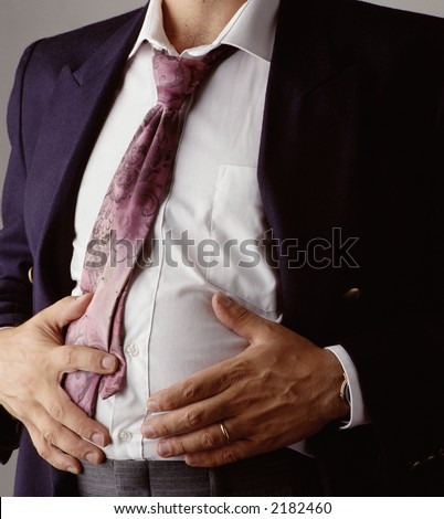 man indigested after a business lunch - stock photo