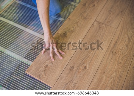 Man Installing New Wooden Laminate Flooring Stock Photo Royalty