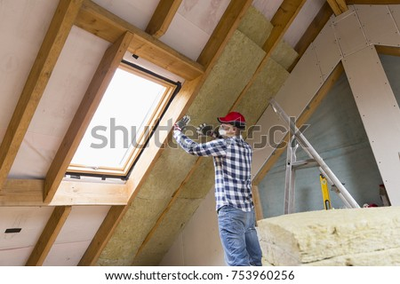 Loft insulation stock images royalty free images for Mineral wool installation
