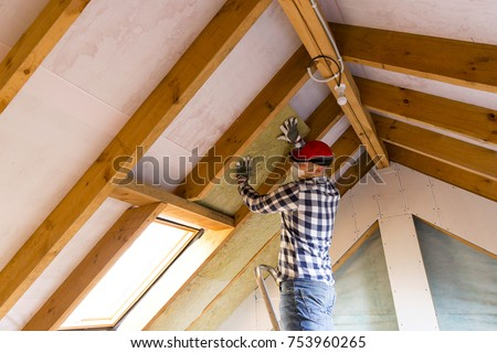 Man Installing Thermal Roof Insulation Layer Stock