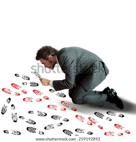 Man investigates and tries the different footprints - stock photo