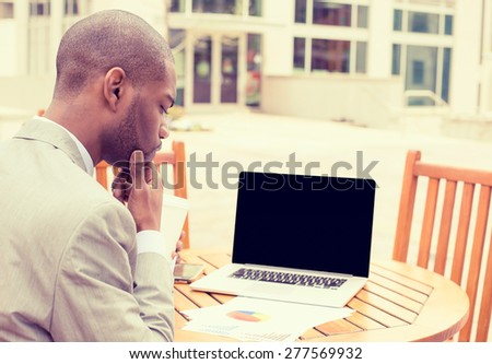 man investment consultant analyzing company annual financial report balance sheet statement working with documents graphs outside outdoor. Stock market, office, tax, education concept. - stock photo
