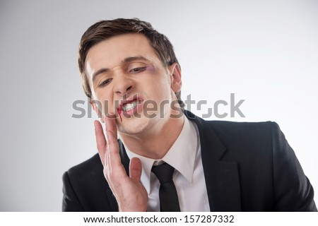 Man is blooding after strike - stock photo